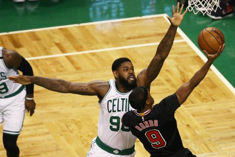Amir Johnson of the Boston Celtics defends a shot by Rajon Rondo of the Chicago Bulls in Game Two of the Eastern Conference quarter-finals, at TD Garden in Boston, Massachusetts, on April 18, 2017