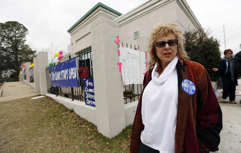 "Clinic owner Diane Derzis stands outside the Jackson Women's Health Organization Inc., Mississippi's only commercial abortion clinic in Jackson, Miss., Tuesday, Jan. 22, 2013. Derzis said the anniversary of the Roe vs. Wade decision was ""a celebration of 40 years of safe medical services."" Activists pro-and anti-abortion marked 40 years since a U.S. Supreme Court ruling established a nationwide right to abortion, with protests at the Capitol and at the clinic. (AP Photo/Rogelio V. Solis)"