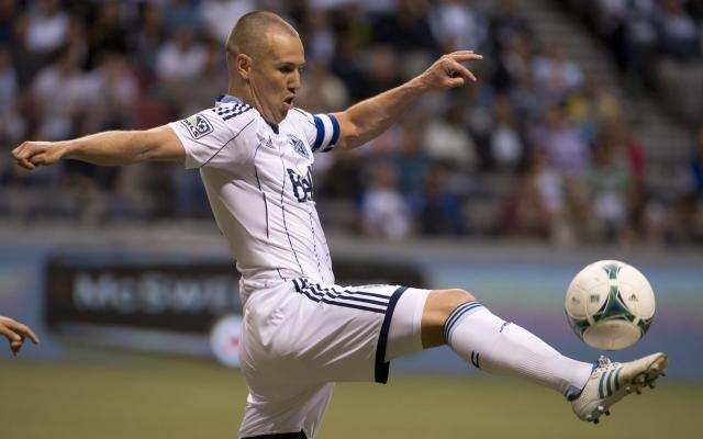 Vancouver Whitecaps FC's Kenny Miller takes control of the ball against Chivas USA during the first half of an MLS soccer game in Vancouver, British Columbia, Wednesday, June, 19, 2013. (AP Photo/The Canadian Press, Jonathan Hayward)