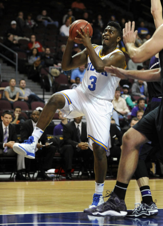 UCLA's Jordan Adams (3) drives to the basket against Northwestern during the first half of an NCAA college basketball game at the Las Vegas Invitational on Friday, Nov. 29, 2013, in Las Vegas. (AP Photo/David Becker)