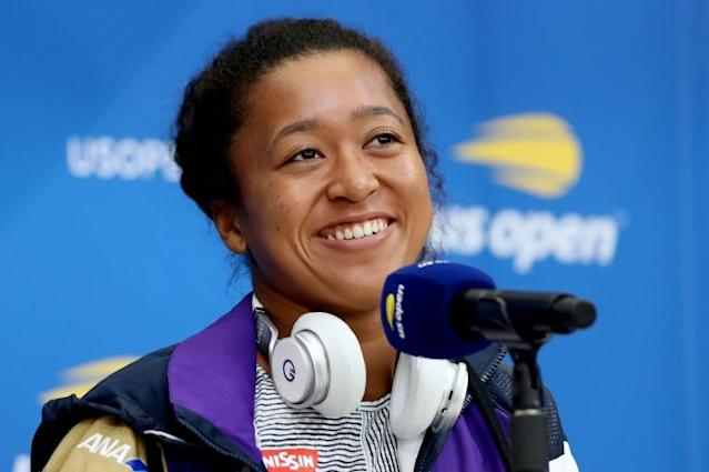 Naomi Osaka is all smiles at media day (AFP Photo/MATTHEW STOCKMAN)