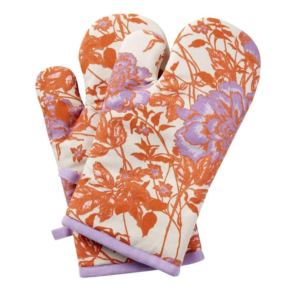 <p>Get cooking with this <span>Drew Barrymore Flower Home Vintage Floral Oven Mitt Two Piece Set</span> ($12).</p>