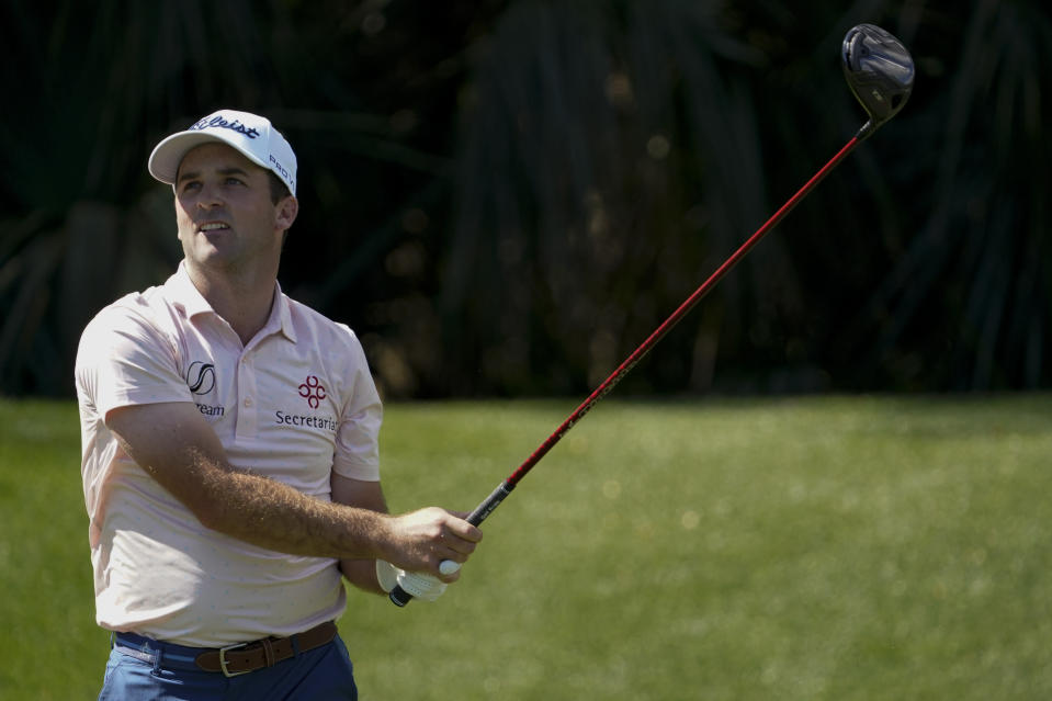 Denny McCarthy watches his tee shot on the seventh hole during the second round of the The Players Championship golf tournament Friday, March 12, 2021, in Ponte Vedra Beach, Fla. (AP Photo/John Raoux)