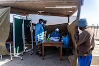 Supplying vaccines has become a new frontier in the battle to gain diplomatic influence in Africa and beyond (AFP/Zinyange Auntony)