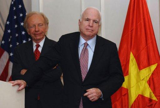 US Senator John McCain (R) speaks next to US Senator Joseph Lieberman (2nd L) at a press conference in Hanoi