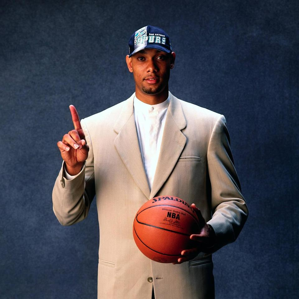 <p>1997: Tim Duncan poses for a photo after being selected by the San Antonio Spurs at the 1997 NBA Draft in New York, New York.<br></p>