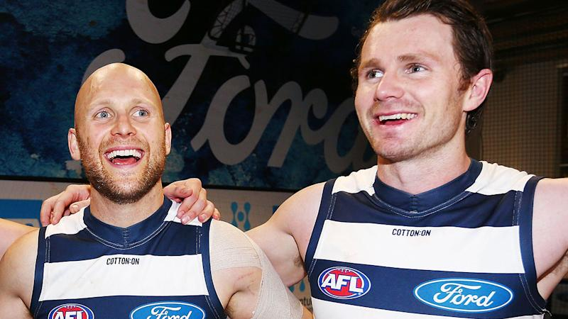 Pictured here, Geelong stars Gary Ablett and Patrick Dangerfield embrace after a match.