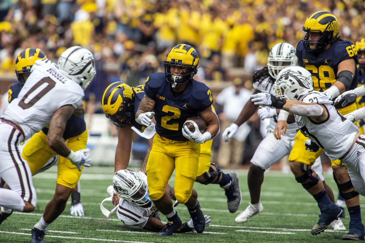 Michigan running back Blake Corum (2) rushes in the first quarter of an NCAA college football game against Western Michigan in Ann Arbor, Mich., Saturday, Sept. 4, 2021. (AP Photo/Tony Ding)