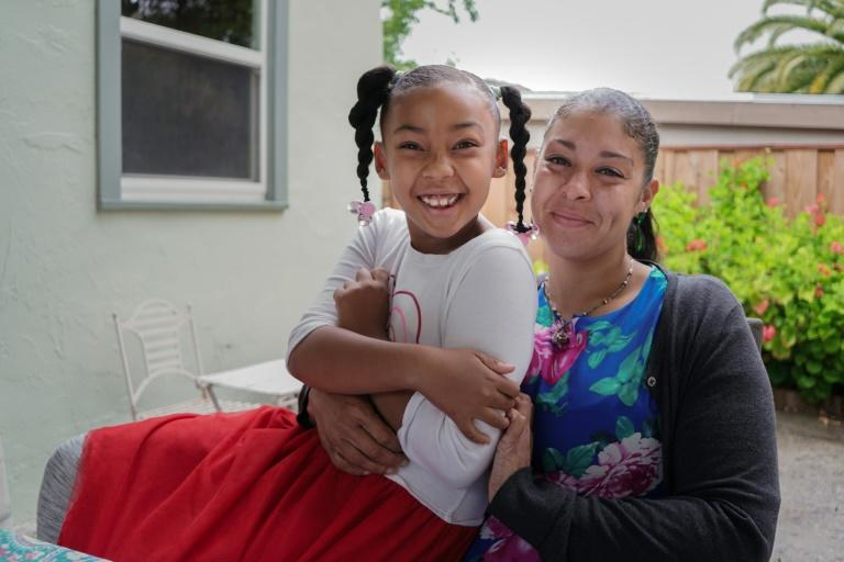 Adrienne Williams with her daughter Gia, 7, at her mother's house in Pinole, California, on May 13, 2020 (AFP Photo/Virginie GOUBIER)