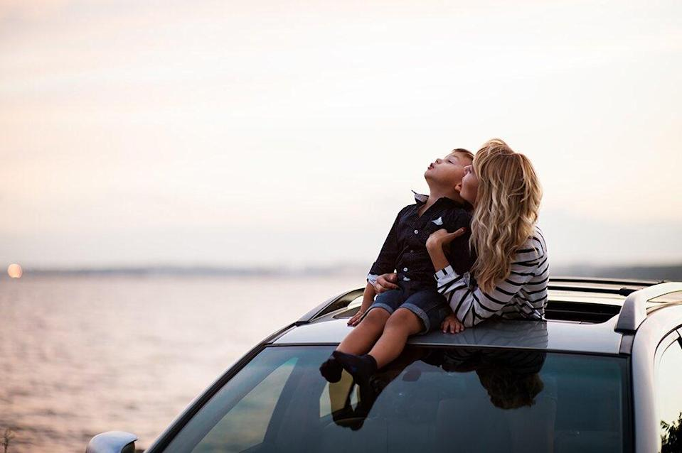 mom and son stargazing in car