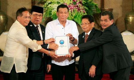 Draft law of the Bangsamoro Basic Law (BBL) during a ceremony at the Malacanang presidential palace in Manila