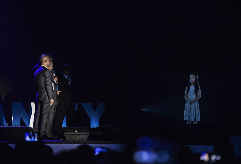 Tun Dr Mahathir Mohamad interact with Aisyah's hologram during the launching of Malaysia's 5G Showcase in Putrajaya April 18, 2019. — Picture by Shafwan Zaidon