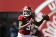 In this photo taken on Saturday, Oct. 12, 2019, Indiana quarterback Michael Penix Jr. (9) throws during the first half of an NCAA college football game against Rutgers, in Bloomington, Ind. The first two seasons for Indiana Hoosiers quarterback Michael Penix Jr. ended prematurely because of injuries. So the redshirt sophomore added 16 pounds to his 6-foot-3 frame in hopes of finishing his first full season. (AP Photo/Darron Cummings)