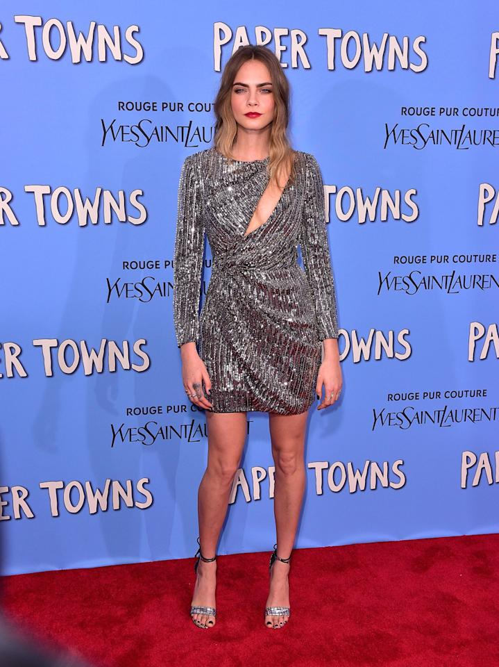 """<p>Cara Delevingne in a silver embellished Saint Laurent cut-out dress.</p><p>It's no surprise that supermodel turned actress Cara Delevingne is wearing her best threads for the press tour for her first feature film, """"Paper Towns."""" She particularly shined at the New York premiere in a silver embellished cutout dress by Saint Laurent.<br /><br /></p>"""
