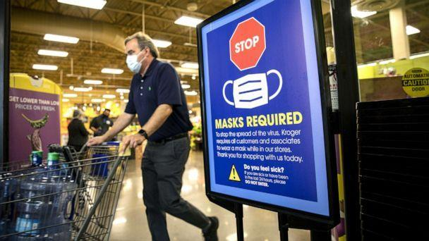 PHOTO: A 'Mask Required' sign at the entrance to a Kroger Co. grocery store in Houston, March 10, 2021.  (Scott Dalton/Bloomberg via Getty Images)