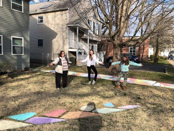 PHOTO: Rachel Alford stands with her children and the rainbow chalk they created to spread hope and joy in their Long Island, New York, community amid the coronavirus crisis. (Rachel Alford)
