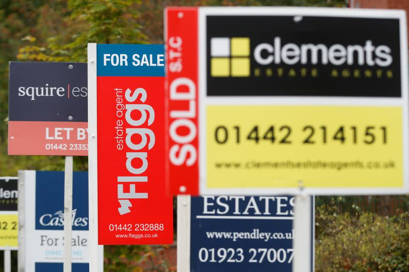 Estate agents' boards are displayed, amid the spread of the coronavirus disease (COVID-19), in Apsley, Hertfordshire