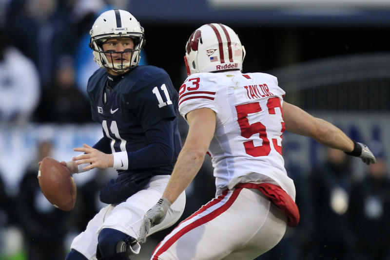 Penn State quarterback Matthew McGloin (11) looks to pass under pressure from Wisconsin linebacker Mike Taylor (53) during the first quarter of an NCAA college football game in State College, Pa., Saturday, Nov. 24, 2012. (AP Photo/Gene J. Puskar)