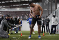 Tulsa linebacker Zaven Collins looks back at the measurement of his broad jump at NFL football pro day Friday, April 2, 2021, in Tulsa, Okla. (AP Photo/Sue Ogrocki)