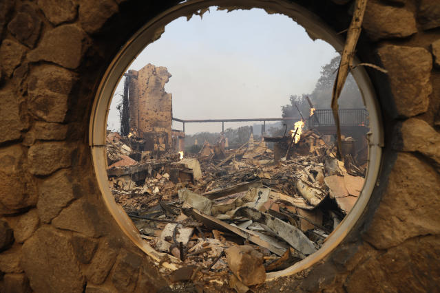 <p>The fire-ravaged Signorello Estate Winery is seen through a window Monday, Oct. 9, 2017, in Napa, Calif. Wildfires whipped by powerful winds swept through Northern California sending residents on a headlong flight to safety through smoke and flames as homes burned. (Photo: Marcio Jose Sanchez/AP) </p>