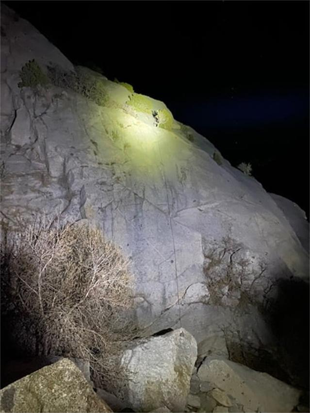 A rescue team with the Salt Lake County Sheriff's Search and Rescue shine a high-powered light to help climbers descend safely in Little Cottonwood Canyon, Utah, on April 9, 2021. (Salt Lake County Sheriff's Search and Rescue via Facebook)