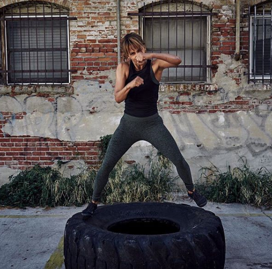 """<p>Halle says she's a huge fan of tire workouts. """"Not ONLY do tire workouts effectively challenge you, bringing out the badass warrior that you are, they are the perfect way to work on both physique AND cardio. Does it get any better than that??"""" she wrote on <a href=""""https://www.instagram.com/p/BvmONGqjqsw/"""" rel=""""nofollow noopener"""" target=""""_blank"""" data-ylk=""""slk:Instagram"""" class=""""link rapid-noclick-resp"""">Instagram</a>.</p>"""
