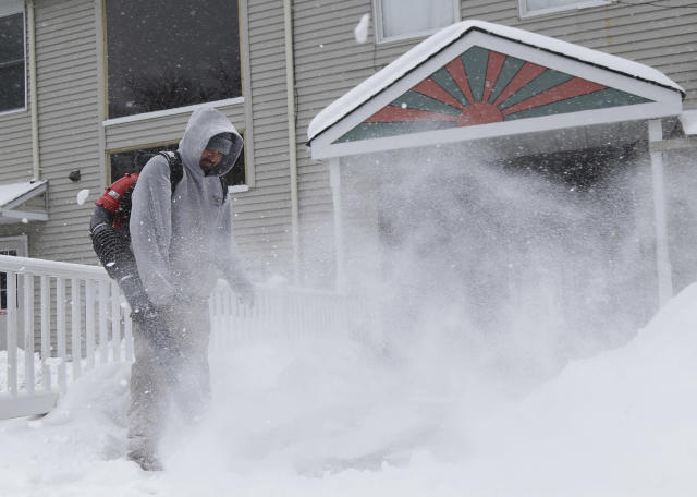 <p>Julio Carrera-Veliz uses a blower to clear walkways of snow in Chester, N.J., Wednesday, March 21, 2018. A spring nor'easter targeted the Northeast on Wednesday with strong winds and a foot or more of snow expected in some parts of the region. (Photo: Seth Wenig/AP) </p>
