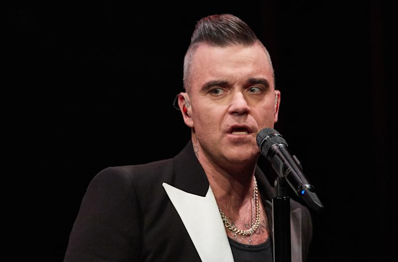 05 December 2019, Hamburg: The singer Robbie Williams stands on stage in the Kehrwieder Theater and gives a fan concert. Photo: Georg Wendt/dpa (Photo by Georg Wendt/picture alliance via Getty Images)