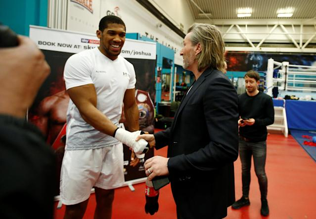 Boxing - Anthony Joshua Media Session - Sheffield, Britain - March 21, 2018 Anthony Joshua shakes hands with Robbie Savage during the media session Action Images via Reuters/Andrew Couldridge