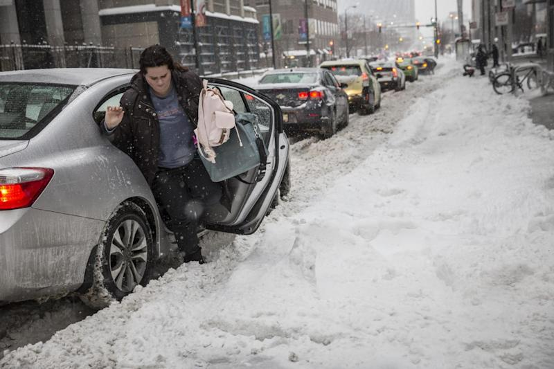 A woman struggles to leave her car in Chicago (AP)