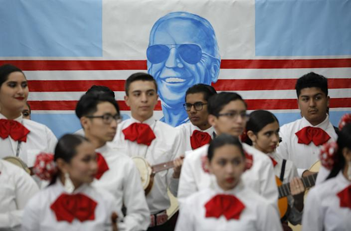 Mariachi band waits to perform before a campaign event for Joe Biden