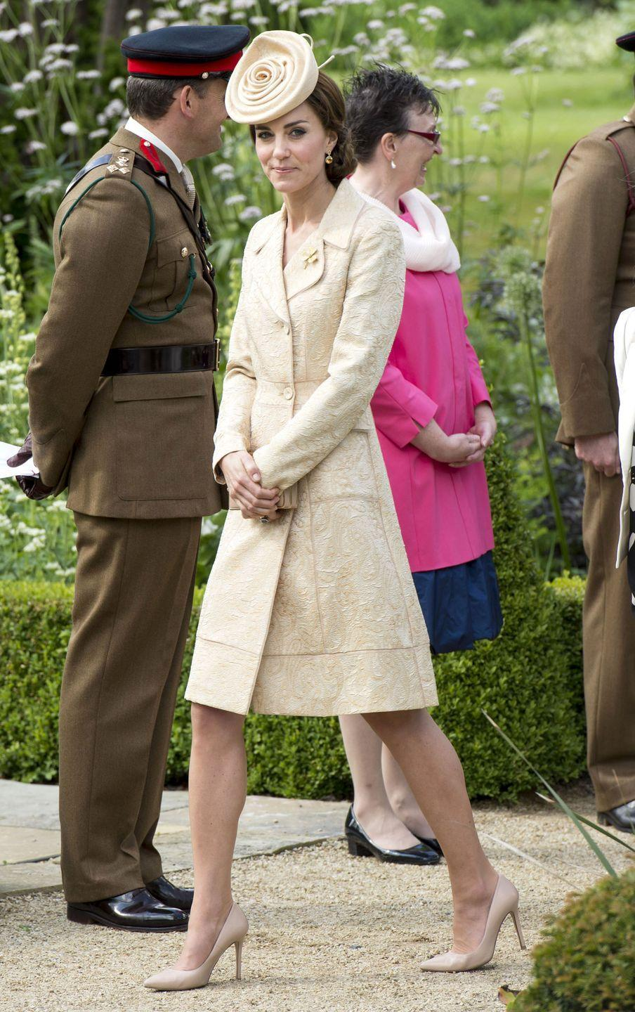 <p>Kate Middleton attends a garden party in Northern Ireland in a beige coat dress by Day Birger et Mikkelsen with matching pumps and a rosette hat by Lock & Co.</p>