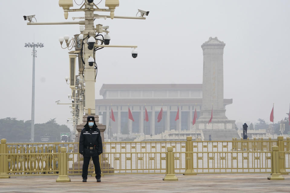A Chinese police officer guards an empty Tiananmen Square near the Great Hall of the People in Beijing on Wednesday, March 3, 2021. In a sign of confidence China has reverted back to holding its annual Congress meetings to march this year after delaying them due to the outbreak of the coronavirus last year. As usual, security has been tightened in the capital with paramilitary troops patrolling near the Great Hall of the People where the meetings are held and standing guard at subway stations. (AP Photo/Ng Han Guan)