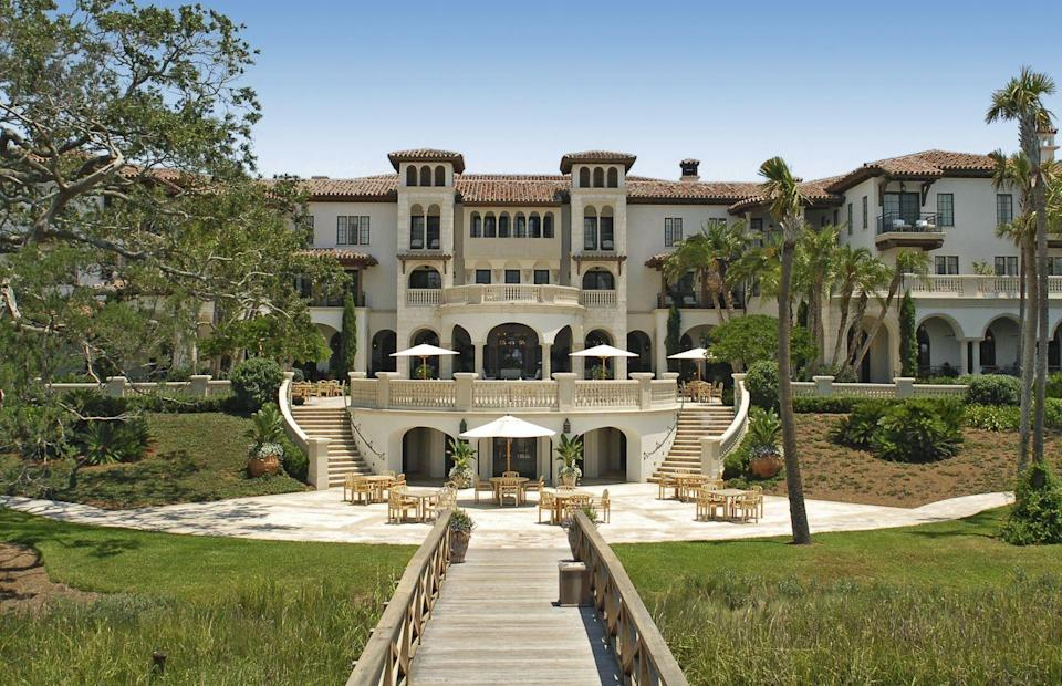 """<p>Seated in between Savannah and Jacksonville, this private island escape is perfect for socially distanced vacationing and romantic getaways alike. <a href=""""https://www.seaisland.com/accommodations/the-cloister/"""" rel=""""nofollow noopener"""" target=""""_blank"""" data-ylk=""""slk:The Cloister at Sea Island"""" class=""""link rapid-noclick-resp"""">The Cloister at Sea Island</a> features luxury elegance at its finest on Georgia's Gold Coast, seated on 50 acres of river, saltwater marshes, and sea. Guests can choose from staying in the main building, its beach club, or private residences to create the perfect stay. </p><p>There's truly something for everyone here at The Cloister, whether you want to spend all day at the beach, exploring the area's unique terrain, or stay indoors. This property has offered luxurious Gold Coast stays for more than 90 years, and that shows through its blend of modern and traditional amenities. Take a historic tour, go horseback riding, try falconry, and try the latest facial craze all in one day before unwinding with a 1920's-inspired cocktail at the Georgian Room Lounge. </p>"""