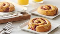 """<p>Cinnamon rolls are <a href=""""https://www.thedailymeal.com/eat/iconic-american-breakfast-dishes?referrer=yahoo&category=beauty_food&include_utm=1&utm_medium=referral&utm_source=yahoo&utm_campaign=feed"""" rel=""""nofollow noopener"""" target=""""_blank"""" data-ylk=""""slk:an iconic American breakfast"""" class=""""link rapid-noclick-resp"""">an iconic American breakfast</a>, but if you're looking for a way to change up the flavors in your favorite morning meal, these cranberry-orange rolls will do the trick.</p> <p><a href=""""https://www.thedailymeal.com/recipes/bejeweled-cranberry-orange-rolls?referrer=yahoo&category=beauty_food&include_utm=1&utm_medium=referral&utm_source=yahoo&utm_campaign=feed"""" rel=""""nofollow noopener"""" target=""""_blank"""" data-ylk=""""slk:For the Bejeweled Cranberry-Orange Rolls recipe, click here"""" class=""""link rapid-noclick-resp"""">For the Bejeweled Cranberry-Orange Rolls recipe, click here</a>.</p>"""