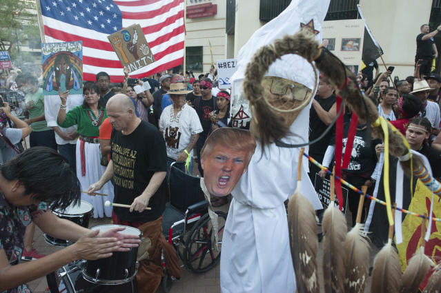 """<p>Demonstrators gather outside the Phoenix, Arizona, Convention Center where US President Donald Trump will be speaking at a """"Make America Great Again"""" rally on August 22, 2017. (Laura Segall/AFP/Getty Images) </p>"""