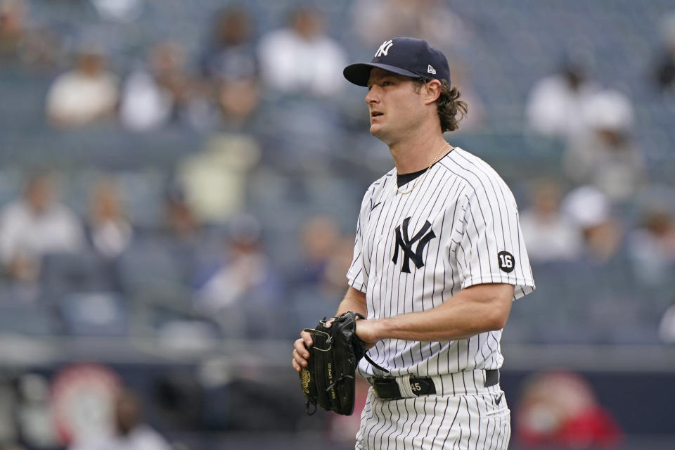 New York Yankees starting pitcher Gerrit Cole (45) reacts heading to the dugout after allowing a two-run home run to Tampa Bay Rays designated hitter Austin Meadows in the fourth inning of a baseball game, Thursday, June 3, 2021, at Yankee Stadium in New York. (AP Photo/Kathy Willens)