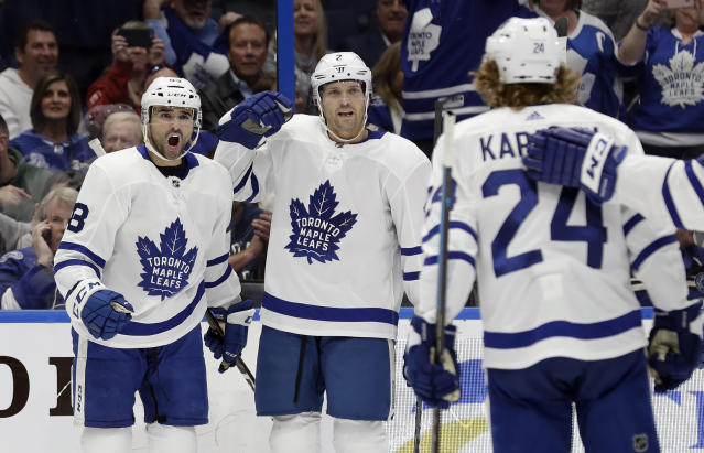 Toronto Maple Leafs center Nazem Kadri (43) celebrates his goal against the Tampa Bay Lightning with defenseman Ron Hainsey (2) and right wing Kasperi Kapanen (24) during the first period of an NHL hockey game, Thursday, Jan. 17, 2019, in Tampa, Fla. (AP Photo/Chris O'Meara)
