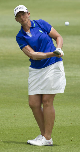 Angela Stanford chips onto the fifth green in the final round of the LPGA LOTTE Championship golf tournament at Ko Olina Golf Club, Saturday, April 19, 2014, in Kapolei, Hawaii. (AP Photo/Eugene Tanner)