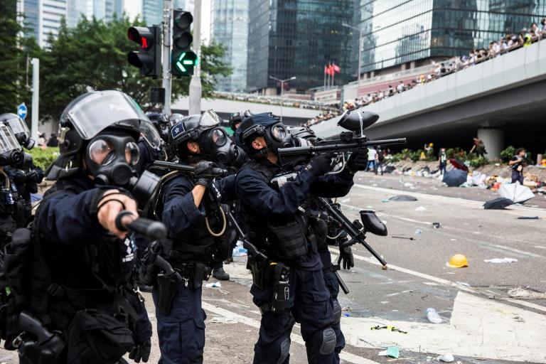 Hong Kong witnessed the worst political violence in a generation as police fought largely young demonstrators opposed to a controversial extradition bill (AFP Photo/ISAAC LAWRENCE)