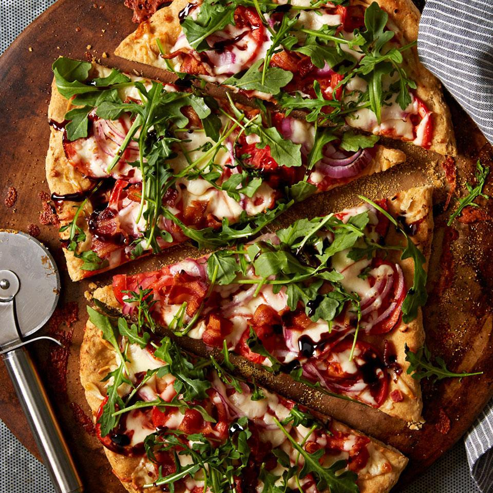 <p>This homemade pizza riffs on the classic BLT sandwich, with crisp bacon, thin roma tomatoes and fresh arugula on top of a whole-wheat pizza crust.</p>