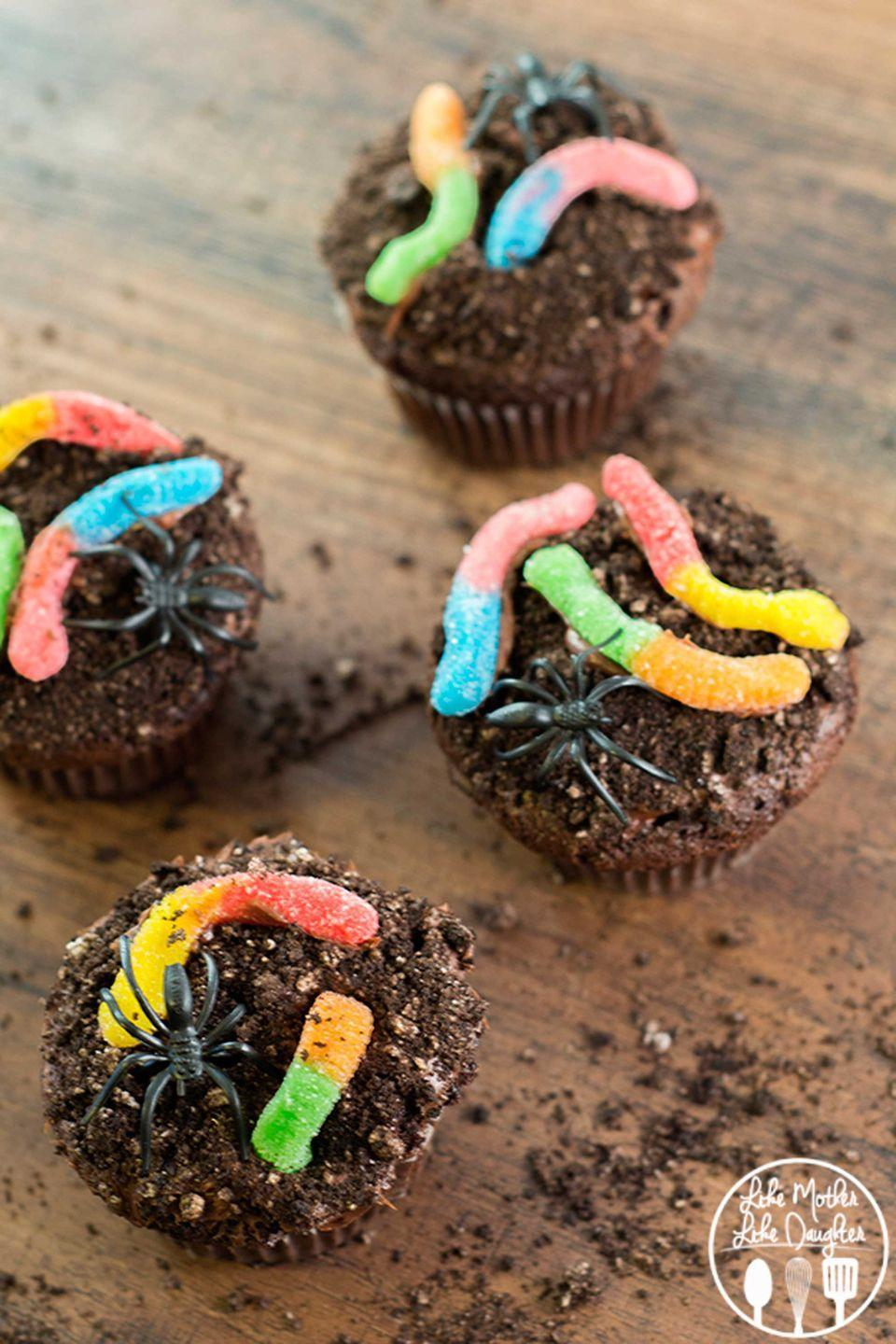 """<p>Simulate a creepy, crawly forest floor with crushed Oreos, gummy worms, and plastic spider toppers. </p><p><strong>Get the recipe at </strong><strong><a href=""""http://lmld.org/2014/10/22/dirt-cupcakes/"""" rel=""""nofollow noopener"""" target=""""_blank"""" data-ylk=""""slk:Like Mother Like Daughter"""" class=""""link rapid-noclick-resp"""">Like Mother Like Daughter</a>.</strong></p>"""