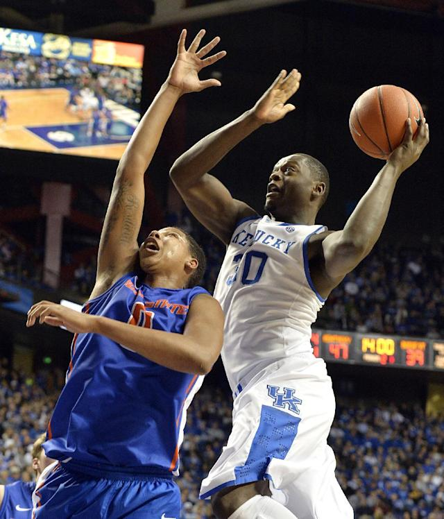 Kentucky's Julius Randle, right, shoots over the outstretched defense of Boise State's Ryan Watkins during the second half of an NCAA college basketball game Tuesday, Dec. 10, 2013, in Lexington, Ky. Kentucky won 70-55. (AP Photo/Timothy D. Easley)