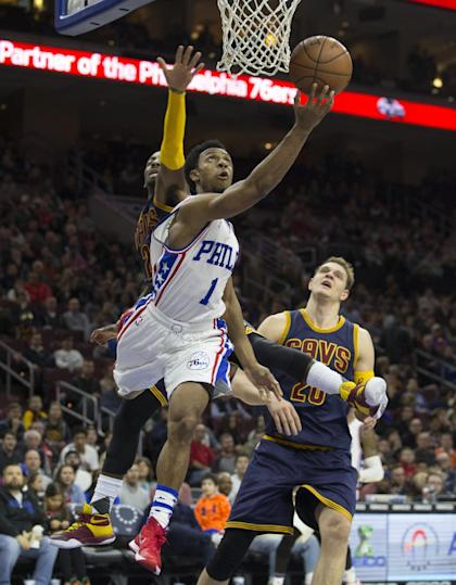 PHILADELPHIA, PA - JANUARY 10: Ish Smith #1 of the Philadelphia 76ers attempts a shot over Kyrie Irving #2 of the Cleveland Cavaliers on January 10, 2016 at the Wells Fargo Center in Philadelphia, Pennsylvania. NOTE TO USER: User expressly acknowledges and agrees that, by downloading and or using this photograph, User is consenting to the terms and conditions of the Getty Images License Agreement. (Photo by Mitchell Leff/Getty Images)