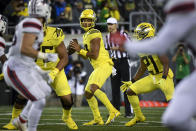 Oregon quarterback Ty Thompson, center, looks for a receiver during the fourth quarter of an NCAA college football game against Stony Brook, Saturday, Sept. 18, 2021, in Eugene, Ore. (AP Photo/Andy Nelson)