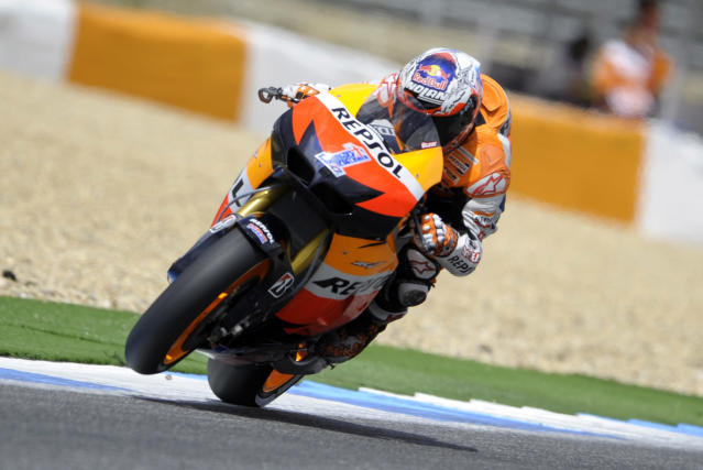 Repsol Honda team's rider Australian rides during the Moto GP qualifying practice of the Portuguese Grand Prix in Estoril, outskirts of Lisbon, on May 5, 2012. Stoner finished in first place, spanish Dani Pedrosa was second and Cal Crutchlow third. AFP PHOTO / MIGUEL RIOPAMIGUEL RIOPA/AFP/GettyImages