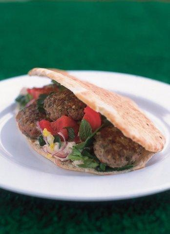 """<p><span>Look to Nigella for advice on serving up lamb this Easter. Instead of the traditional roast, why not try out lamb patties with houmous and pitta? These Middle-Eastern treats are easy to whip up and will work wonders for future garden parties. Take a look at the <a href=""""https://www.nigella.com/recipes/lamb-patties-with-hummus-and-pitta"""" rel=""""nofollow noopener"""" target=""""_blank"""" data-ylk=""""slk:recipe"""" class=""""link rapid-noclick-resp"""">recipe</a>. [Photo: Nigella]</span><br></p><p><span><br><strong>Ingredients</strong>:<br>50 grams bulgar wheat<br>500 grams minced lamb<br>4 teaspoons dried mint (or to taste)<br>4 teaspoons dried oregano (or to taste)<br>1 clove garlic<br>zest of 1 lemon<br>olive oil for frying<br>approx. 8 pitta breads<br>1 little gem lettuce (shredded)<br>1 bunch fresh mint (chopped)<br>1 red onion (halved and sliced very thinly)<br>300 grams hummus<br>300 grams greek yoghurt<br>approx. 1 teaspoon ground cumin<br>4 tomatoes<br>2 lemons</span> </p>"""