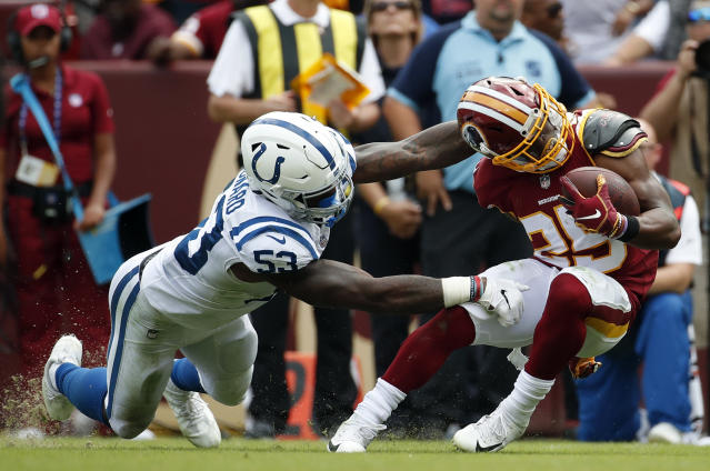 <p>Indianapolis Colts linebacker Darius Leonard, left, tackles Washington Redskins running back Chris Thompson in the second half of an NFL football game, Sunday, Sept. 16, 2018, in Landover, Md. (AP Photo/Alex Brandon) </p>