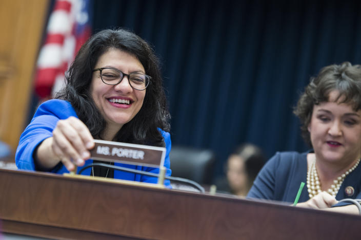 """UNITED STATES - MAY 16: Rep. Rashida Tlaib, D-Mich., left, installs the name plate for Rep. Katie Porter, D-Calif., during a House Financial Services Committee hearing in Rayburn Building titled """"Oversight of Prudential Regulators: Ensuring the Safety, Soundness and Accountability of Megabanks and Other Depository Institutions,"""" on Thursday, May 16, 2019. (Photo By Tom Williams/CQ Roll Call)"""