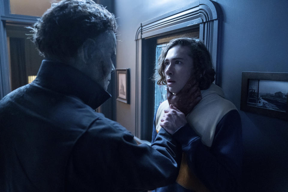 """This image released by Universal Pictures shows Dylan Arnold, right, in """"Halloween Kills,"""" directed by David Gordon Green. (Ryan Green/Universal Pictures via AP)"""